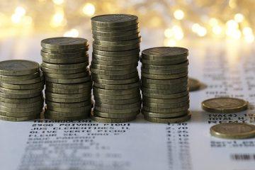 monety na gazecie